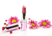 Flowers and pink lipstick — Stock Photo