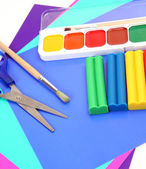 Color paper and paints — Stock Photo