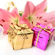 Box with a gift and pink lilies — Stock Photo #26878871