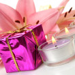 Box with a gift and pink lilies — Stock Photo #26878873