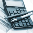 Stock Photo: The calculator and office accessories