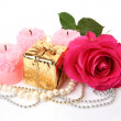 Box with a gift and rose — Stock Photo #26882161