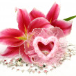 Pink lilies and heart — Stock Photo