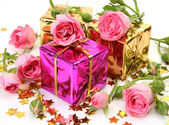 Gifts and roses — Stock Photo