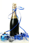 New Year's ornaments and champagne — Stock Photo