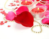 Petals of roses and candles — Stock Photo