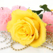 Stockfoto: Yellow rose and candles
