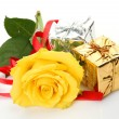 Yellow rose and gifts — Stock Photo