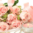 Stock Photo: Roses and a candle