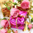 Roses and a gift — Stock Photo