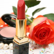 Lipstick and roses — Stock Photo