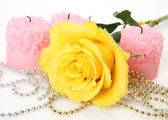 Yellow rose and candles — Stock Photo