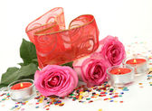 Pink roses and candles — Stock Photo