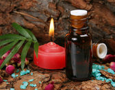 Aromatic oil and candles — Stock Photo