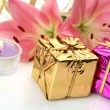 Pink lilies and gifts — Stock Photo #29976267