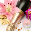 Champagne and pink lilies — Stock Photo