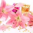 Stock Photo: Pink lilies and gifts