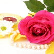 Pink rose and burning candle — Stock Photo