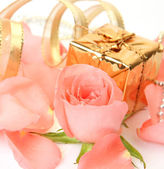 Box with a gift and rose — Stock Photo
