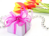 Gifts and flowers — Stock Photo