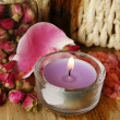 Petals of a rose and candle — Stock Photo