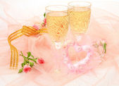 Champagne and wedding accessories — Stock Photo
