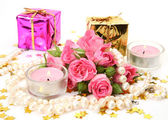 Bouquet of roses and candles — Stock Photo
