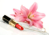 Pink lilies and lipstick — Stock Photo
