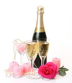 Champagne, candles, pearls and roses — Stock Photo