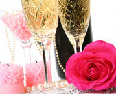 Champagne, candles, pearls and roses — Stok fotoğraf