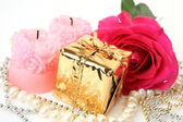 Pink rose and gift — Stock Photo