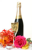 Champagne, candles, gifts and roses — 图库照片