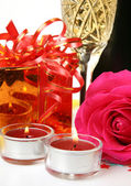 Champagne, candles, gifts and roses — Stok fotoğraf