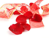 Petals of roses and tape — Stock Photo