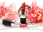 Lipstick and flower — Stock Photo