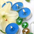Fine lilies and candles — Stock Photo