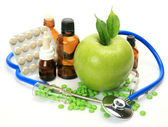 Apple, medicine and stethoscope — Photo