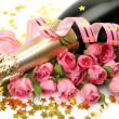 Champagne and pink roses — Stock Photo #35579633
