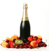 Fruits and champagne — Stock Photo