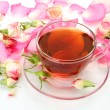 Tea and petals of roses — Stock Photo