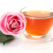 Tea and pink rose — Stockfoto