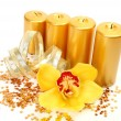 Yellow orchid and candles — Stock Photo