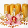 Yellow orchid and candles — Stock Photo #36086183
