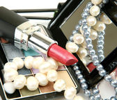 Decorative cosmetics and candles — Stock Photo