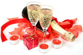 Champagne and petals with candles — Stock Photo