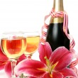 Champagne and pink lily — Stockfoto