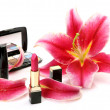 Decorative cosmetics and petals of pink lilies — Stock Photo