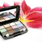 Decorative cosmetics and petals of pink lilies — Stok fotoğraf