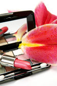 Decorative cosmetics and petals of pink lilies — Foto de Stock