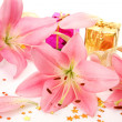 Box with a gift and pink lilies — Stock Photo